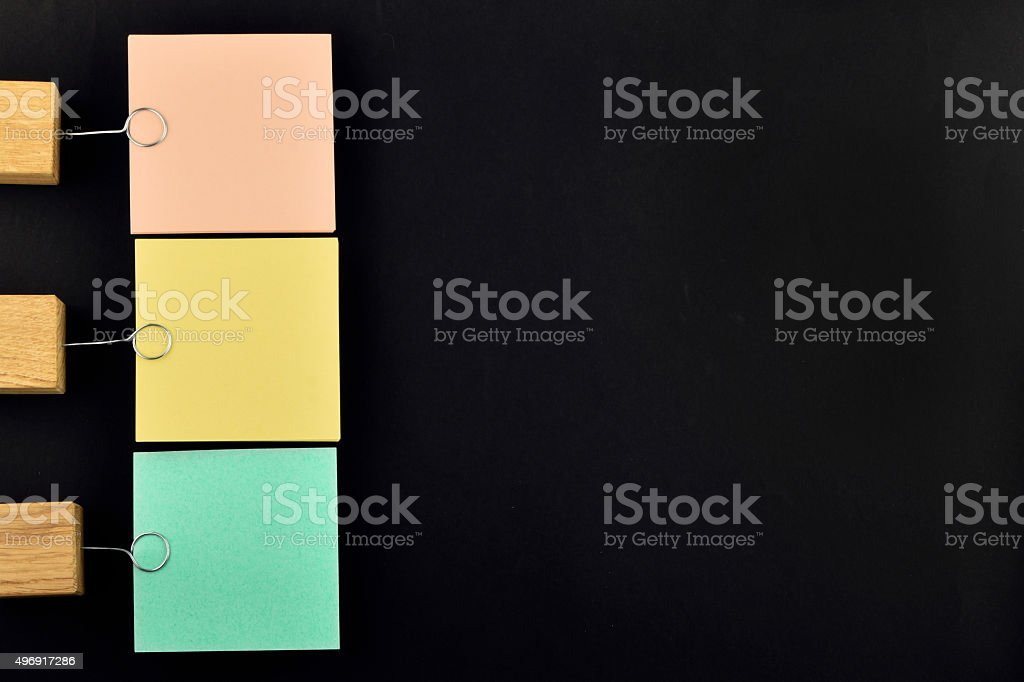 List, three paper notes with holder on black for presentation royalty-free stock photo