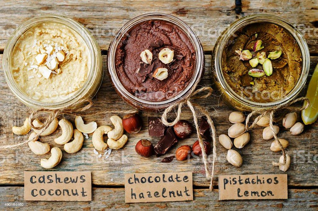 list toasted nut butters, pistachio, hazelnut and cashew stock photo
