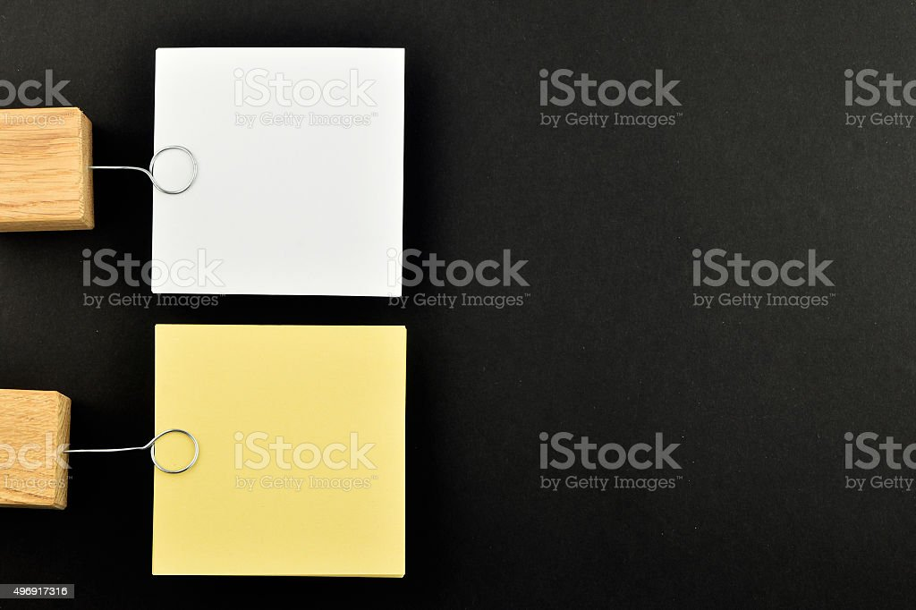 List, Two paper notes with holders on black for presentation royalty-free stock photo