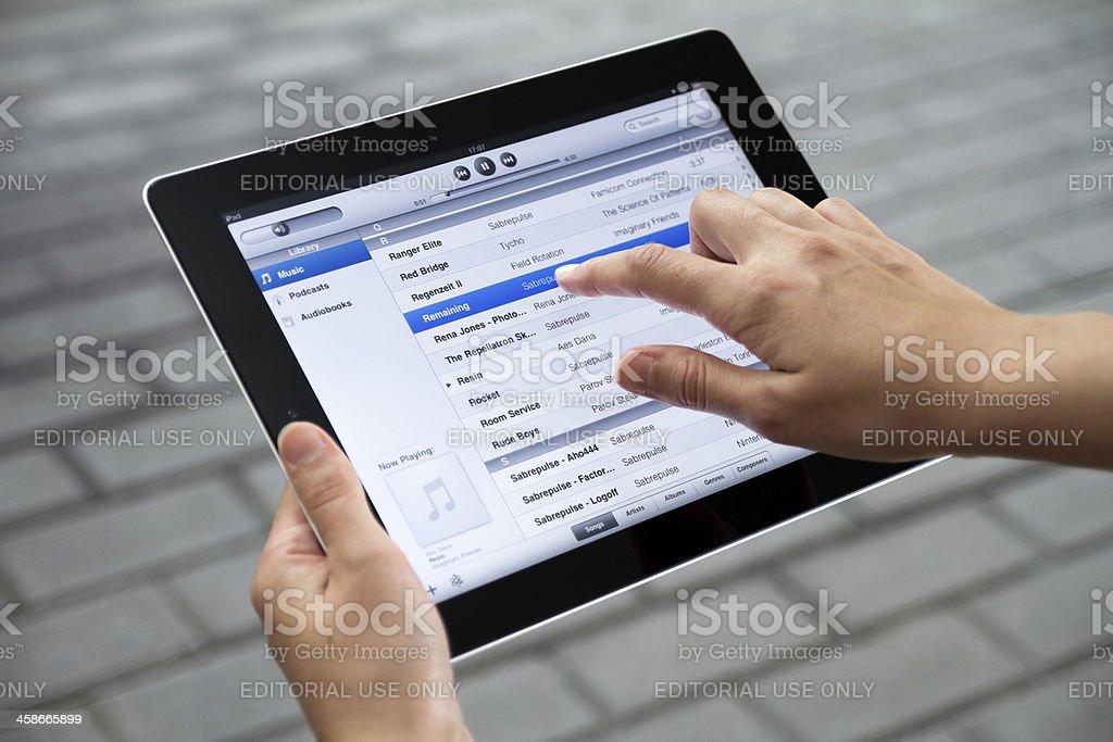 Listen Music on Apple Ipad2 stock photo