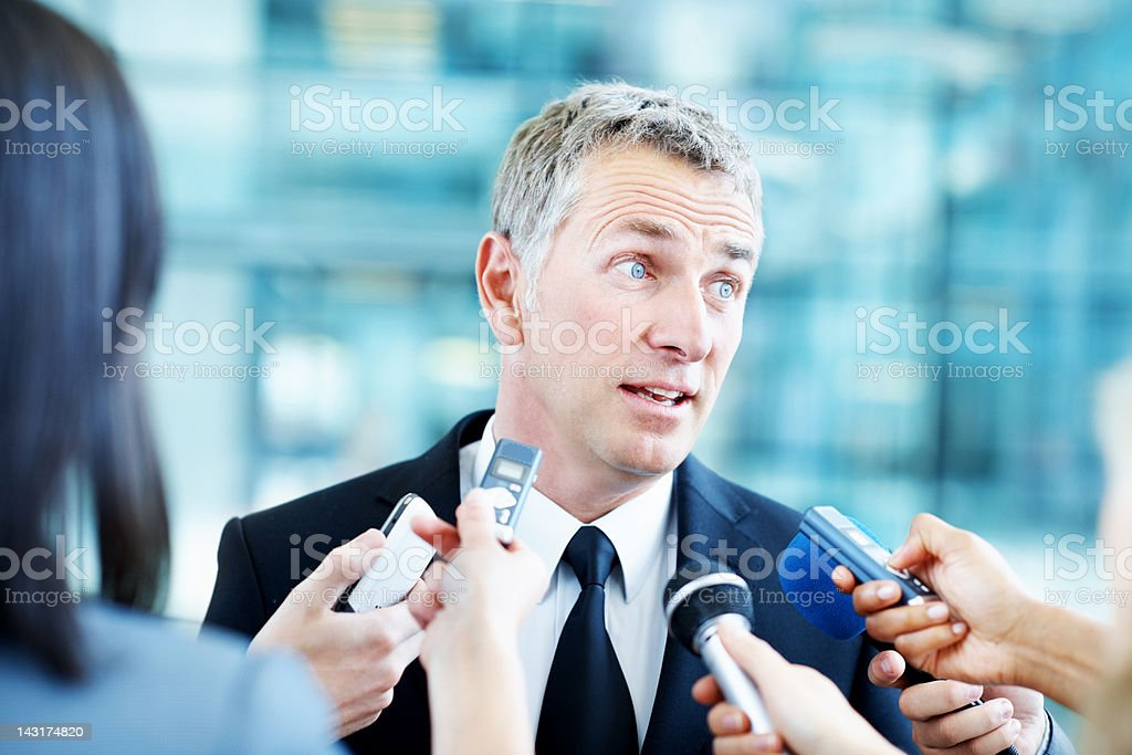 Listening carefully to answer fairly royalty-free stock photo