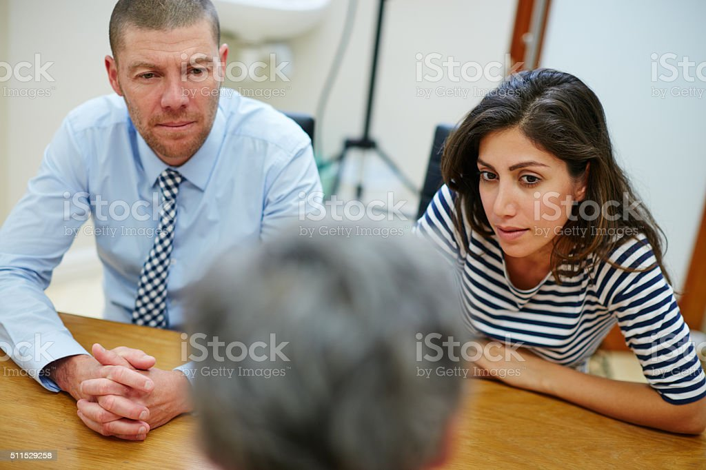 Listening intently to her advice stock photo