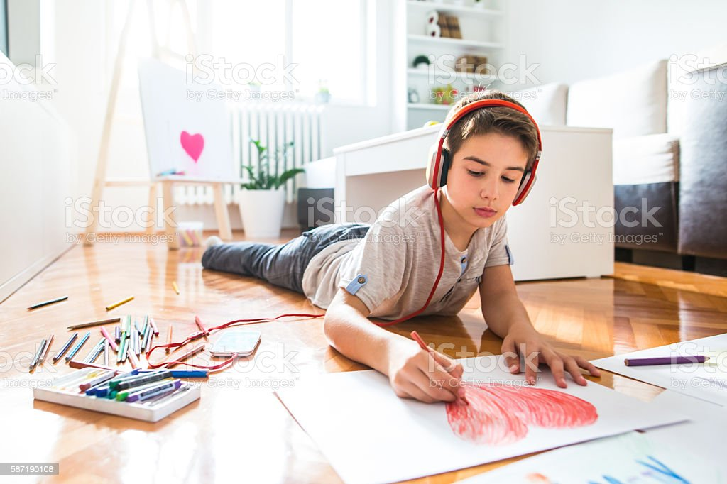Listening music and drawing at home stock photo
