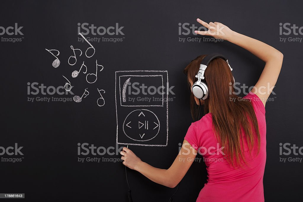 Listening music from Mp3 player royalty-free stock photo