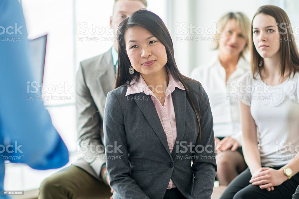 Listening to a Business Presentation stock photo