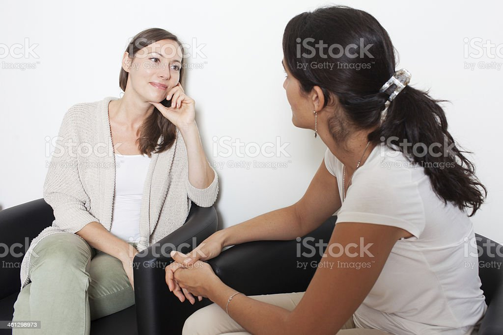 listening to a friend stock photo