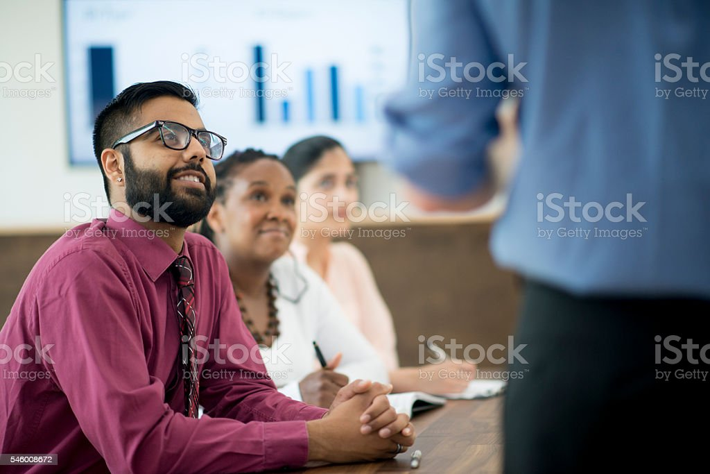 Listening to a Presentation at Work stock photo