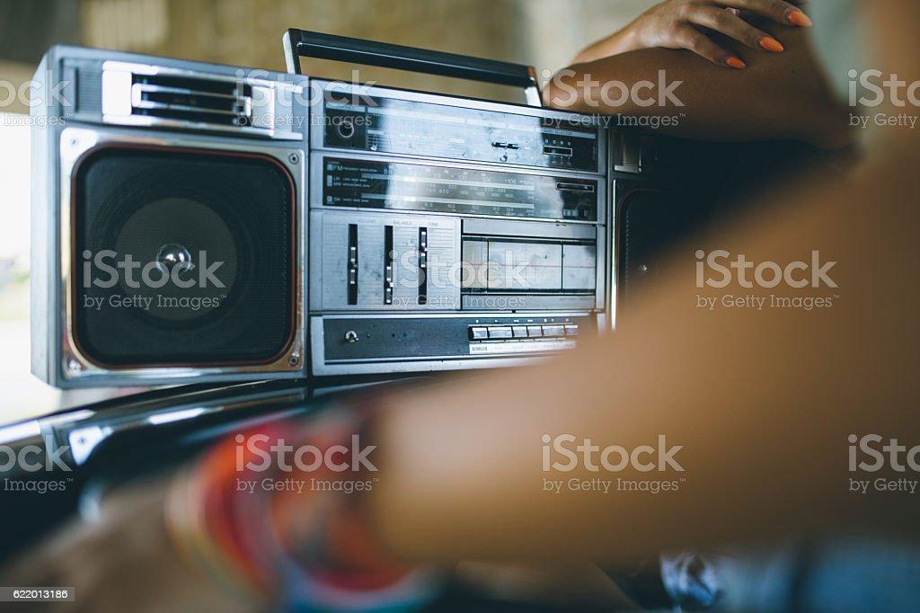 Listening to boom box stock photo
