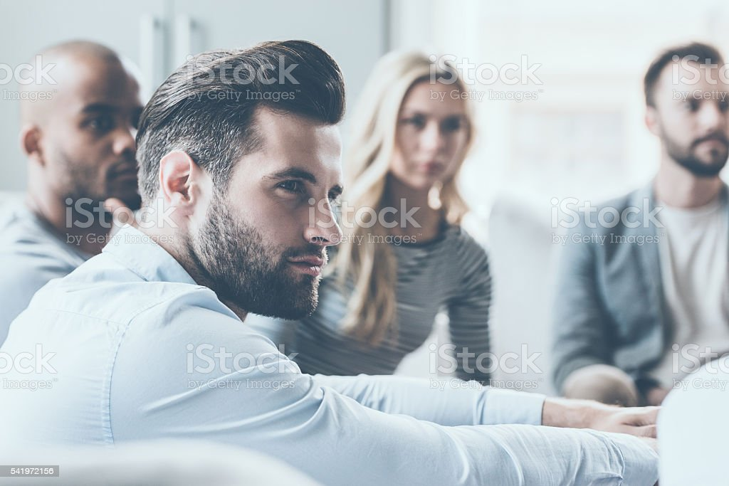 Listening to business coach. stock photo