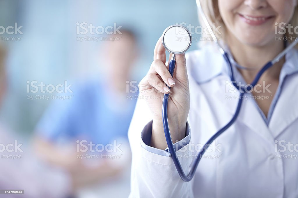 Listening to heartbeat royalty-free stock photo
