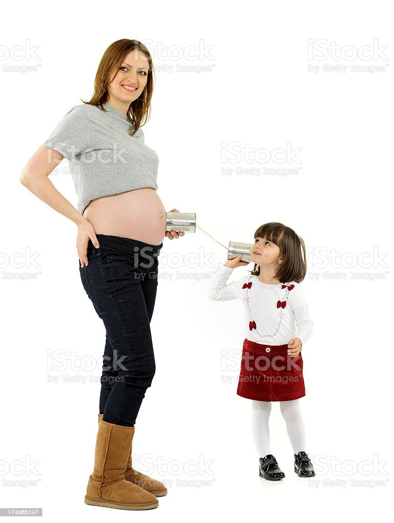 listening to her brother royalty-free stock photo