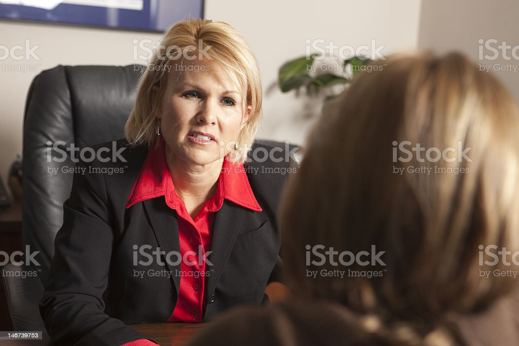 listening to her client royalty-free stock photo