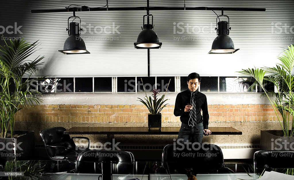 Listening to MP3s at Work royalty-free stock photo