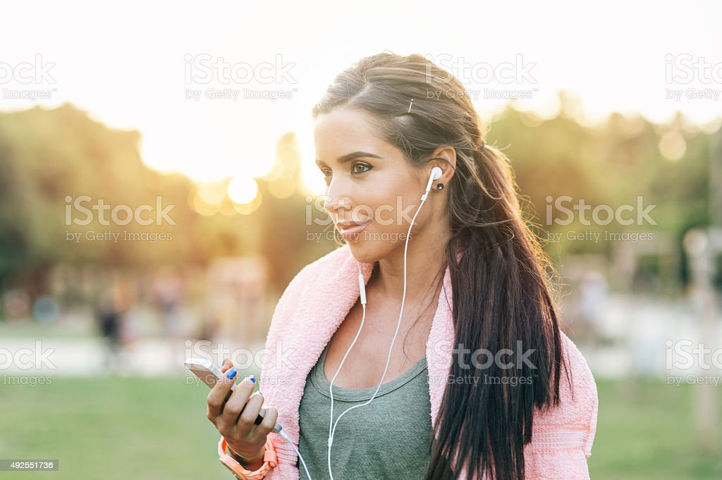 Listening to music during workout stock photo