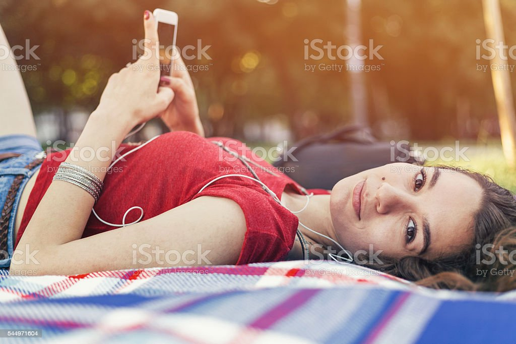 Listening to music in the park stock photo