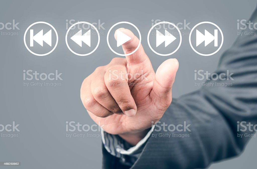 Listening to music pressing play button stock photo