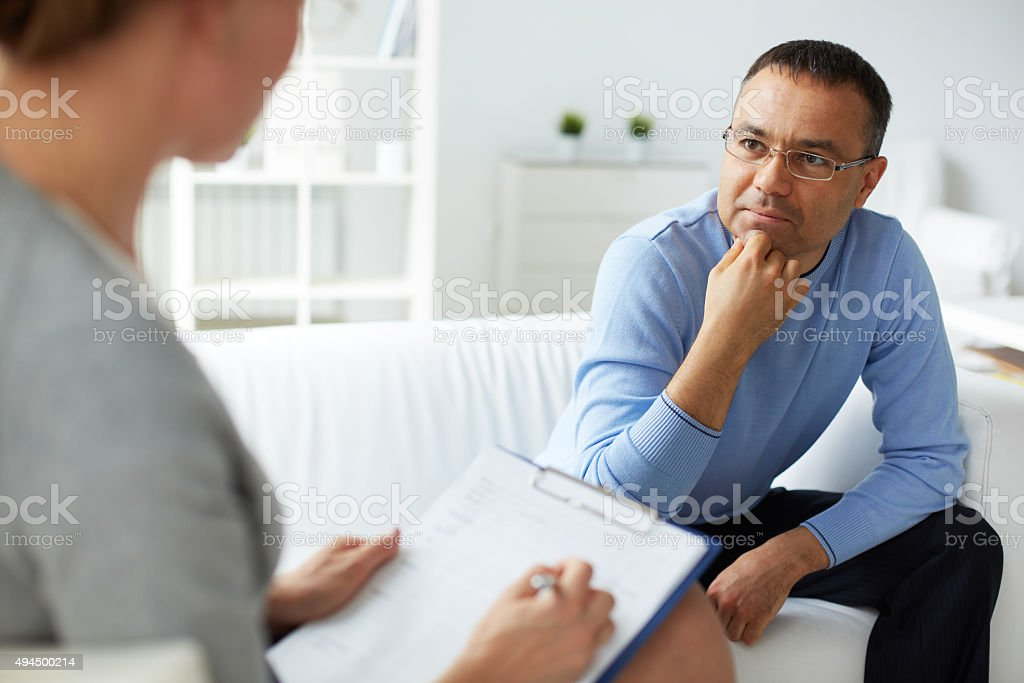 Listening to psychologist stock photo