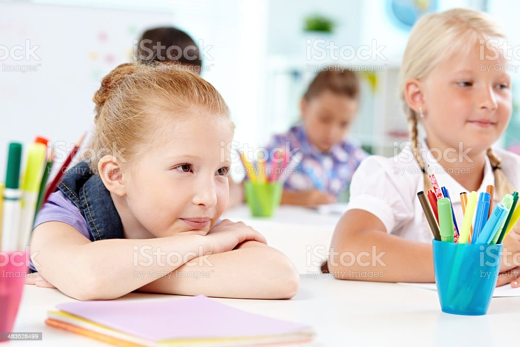 Listening to teacher royalty-free stock photo
