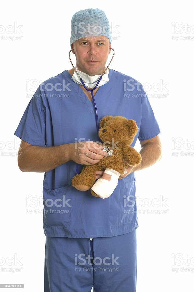 Listening to teddy's heart. royalty-free stock photo