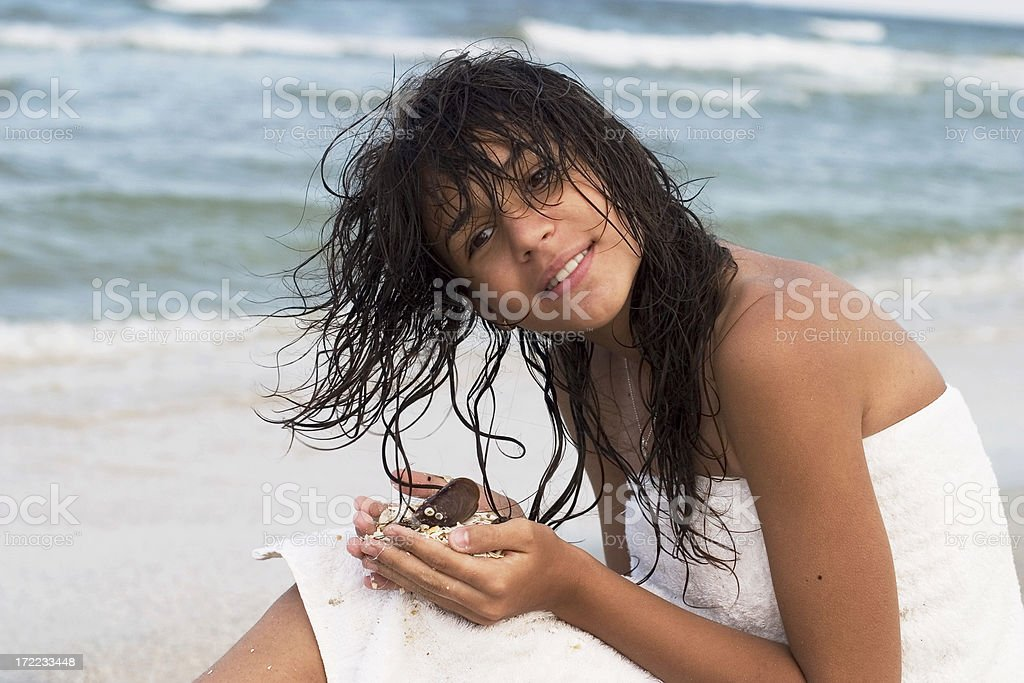 Listening to the shells royalty-free stock photo