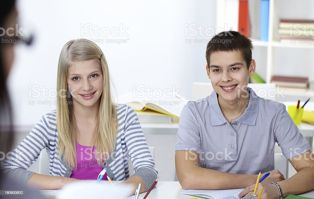 Listening to the teacher royalty-free stock photo