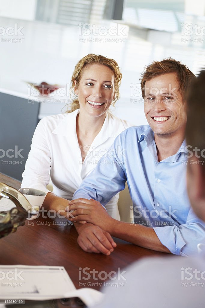 Listening to their financial advisor royalty-free stock photo