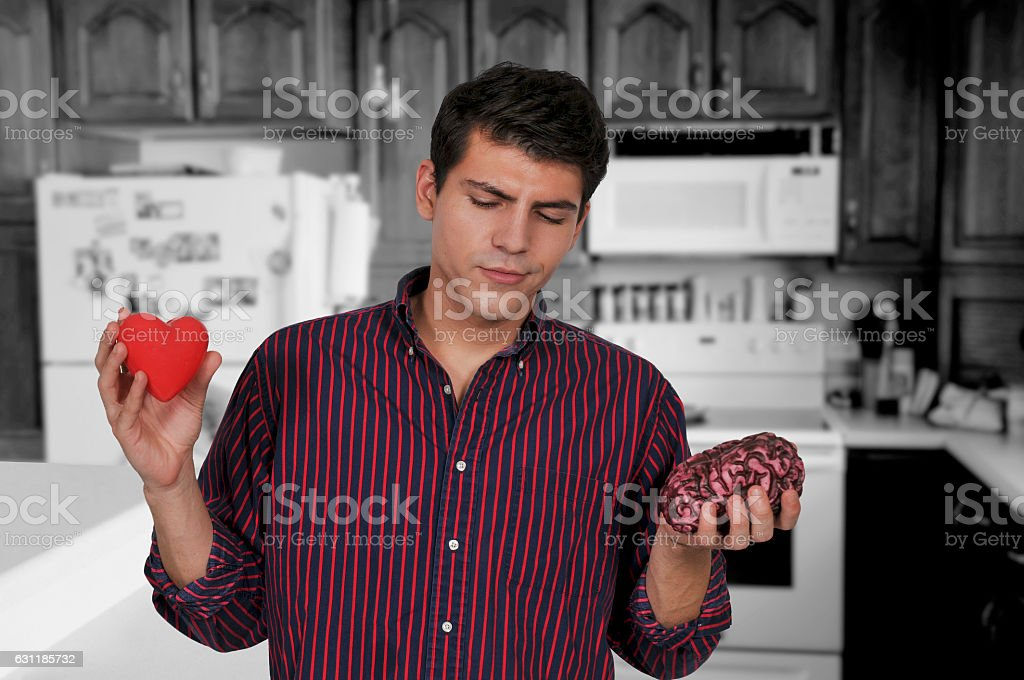 Listening to your brain instead of your heart stock photo