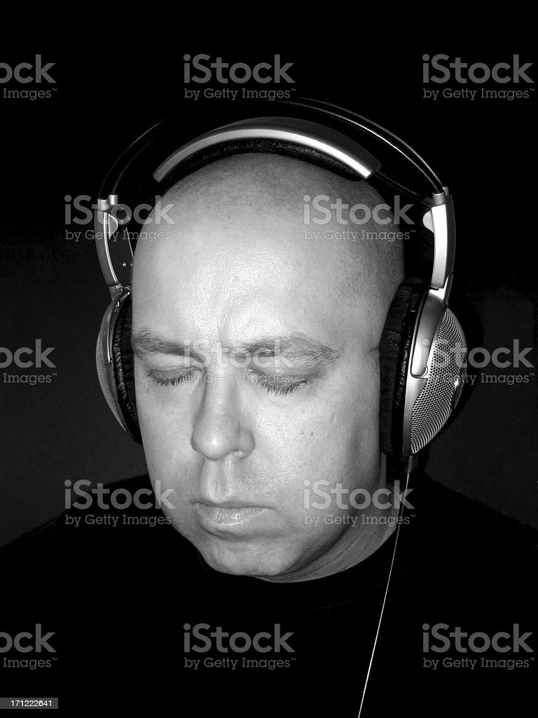 Listening with Headphones royalty-free stock photo