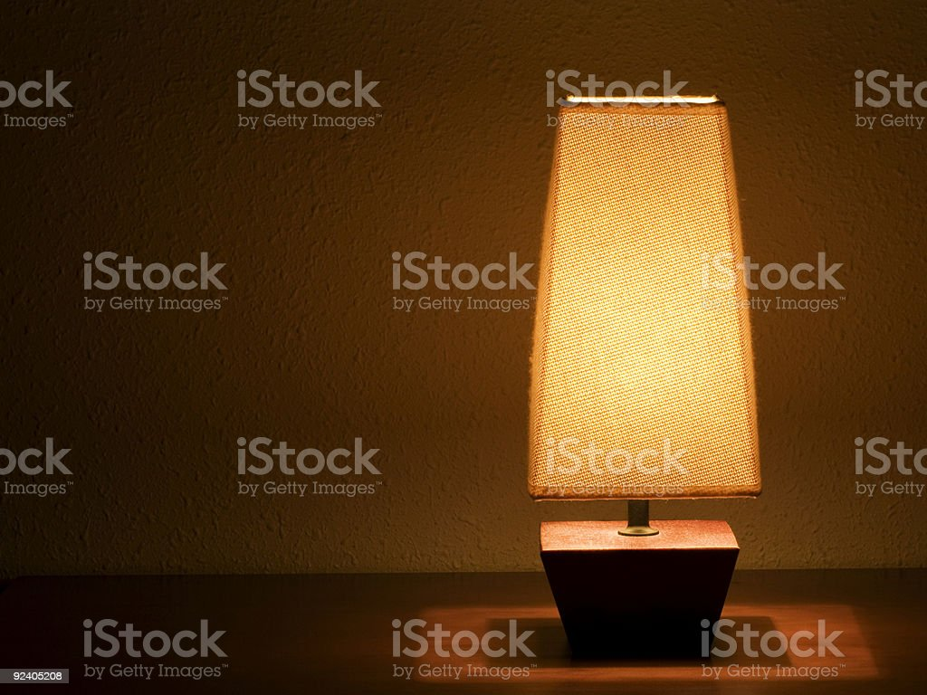 Lit bedside lamp royalty-free stock photo