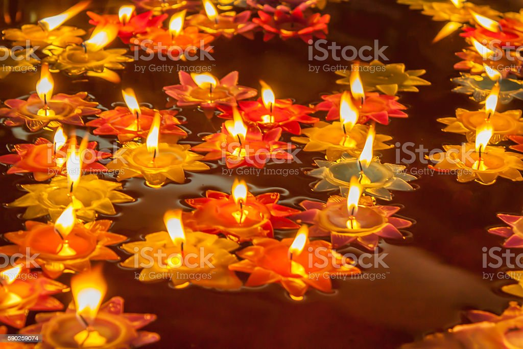 lit candle stock photo