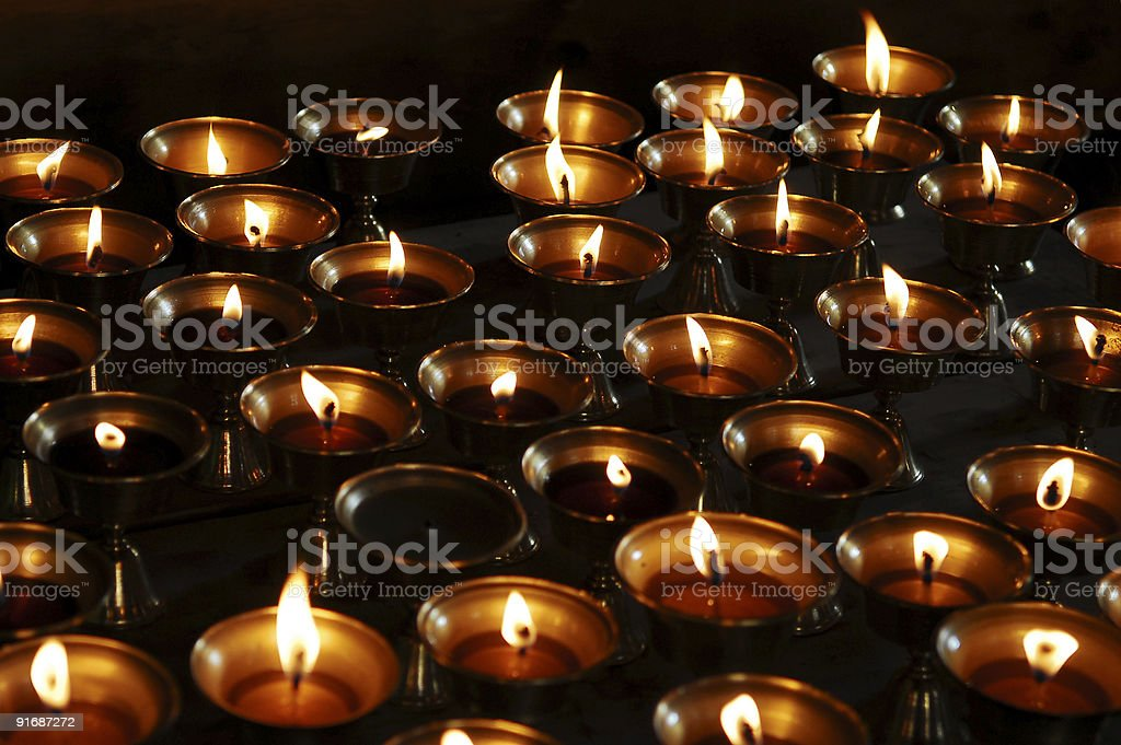 Lit candles, Buddhist offering royalty-free stock photo
