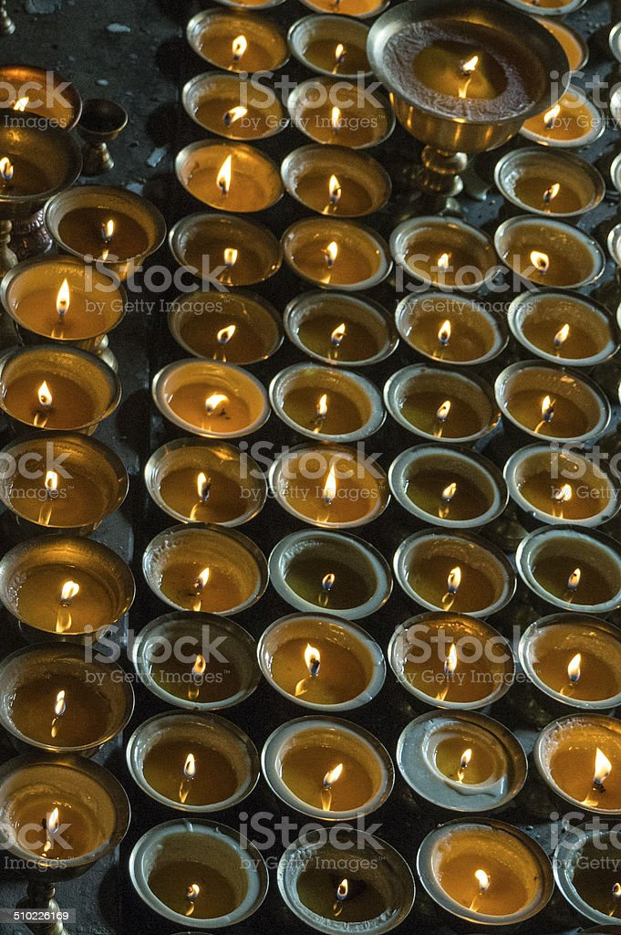Lit candles for buddhist ceremony, vertical view stock photo