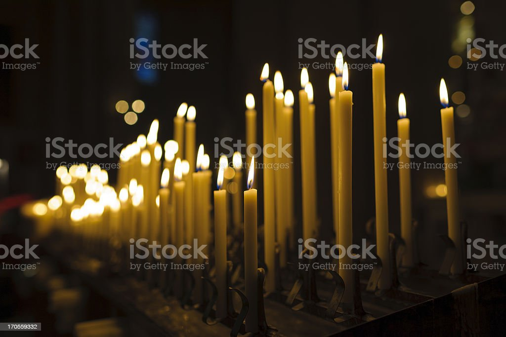 Lit Candles in Church Interior at Christmas stock photo