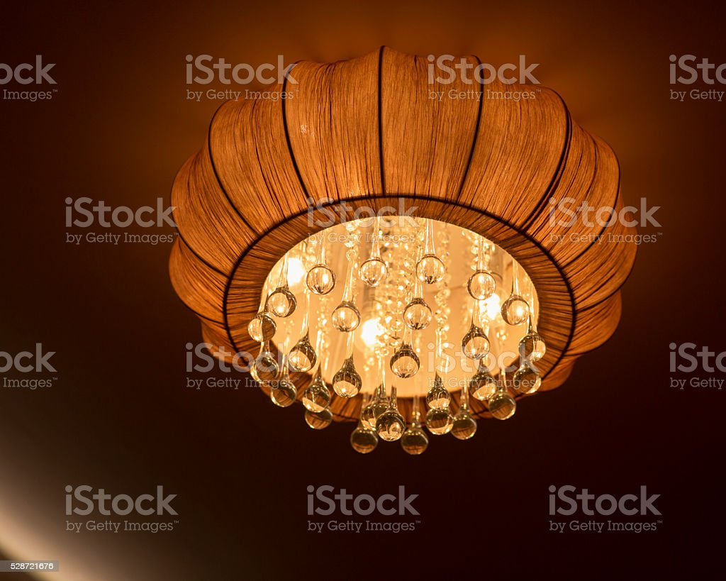 lit chandelier, bedroom interior. stock photo