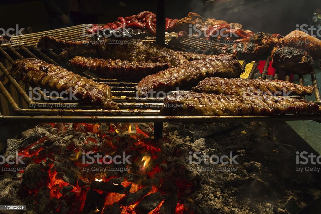 lit grill meat - parrilla encendida con carne stock photo