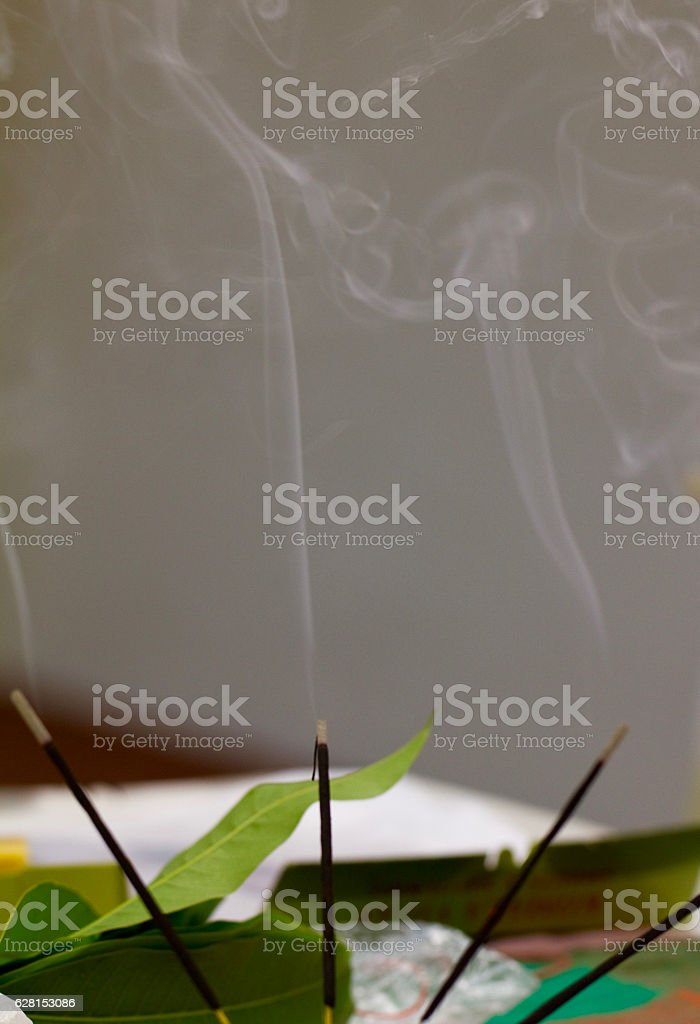 Lit incense sticks (agarbatti) used during puja (prayer) stock photo