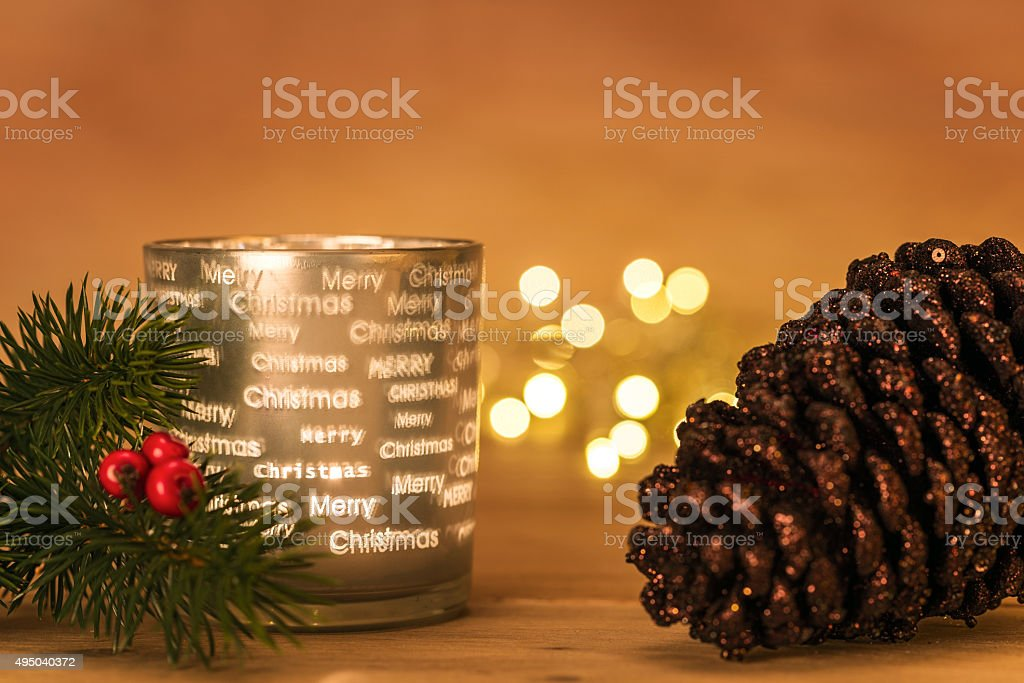 Lit lantern with christmas fir branch and cone with lights stock photo