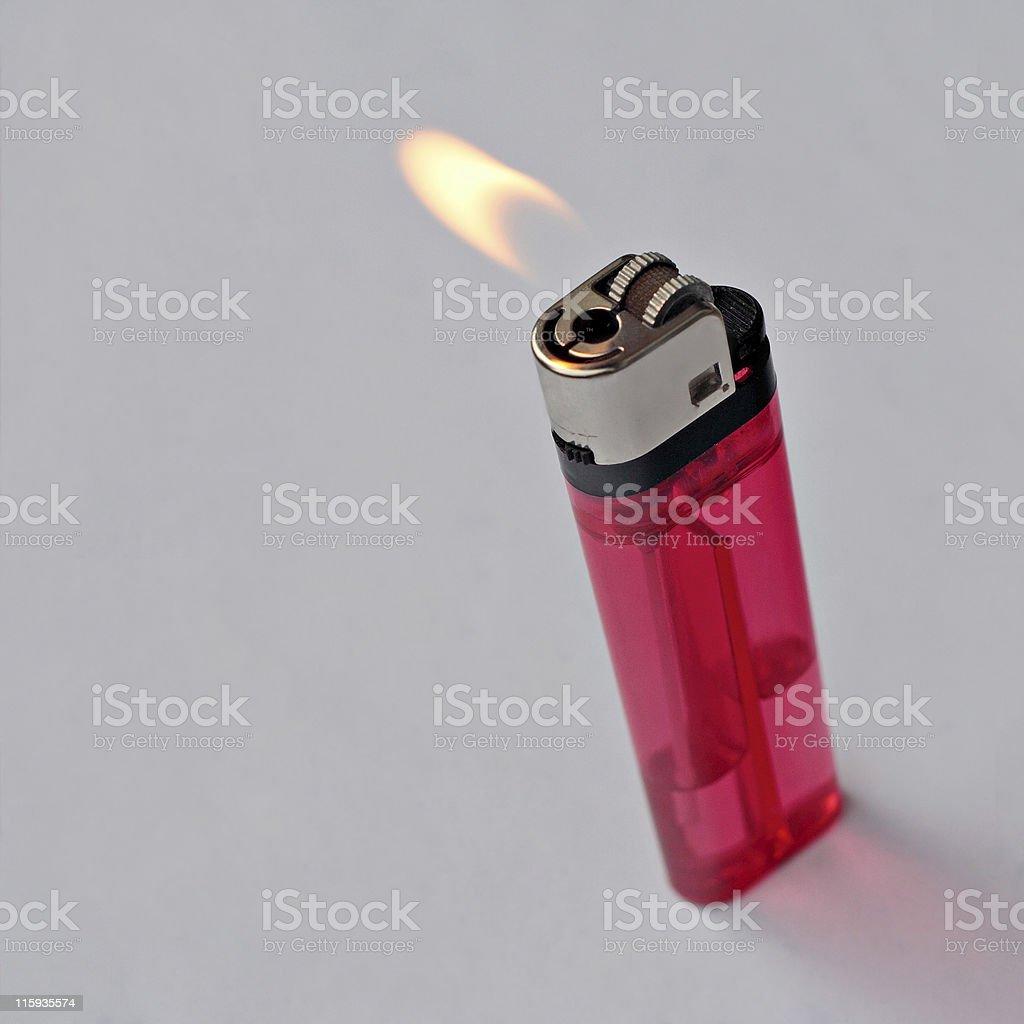 Lit lighter stock photo