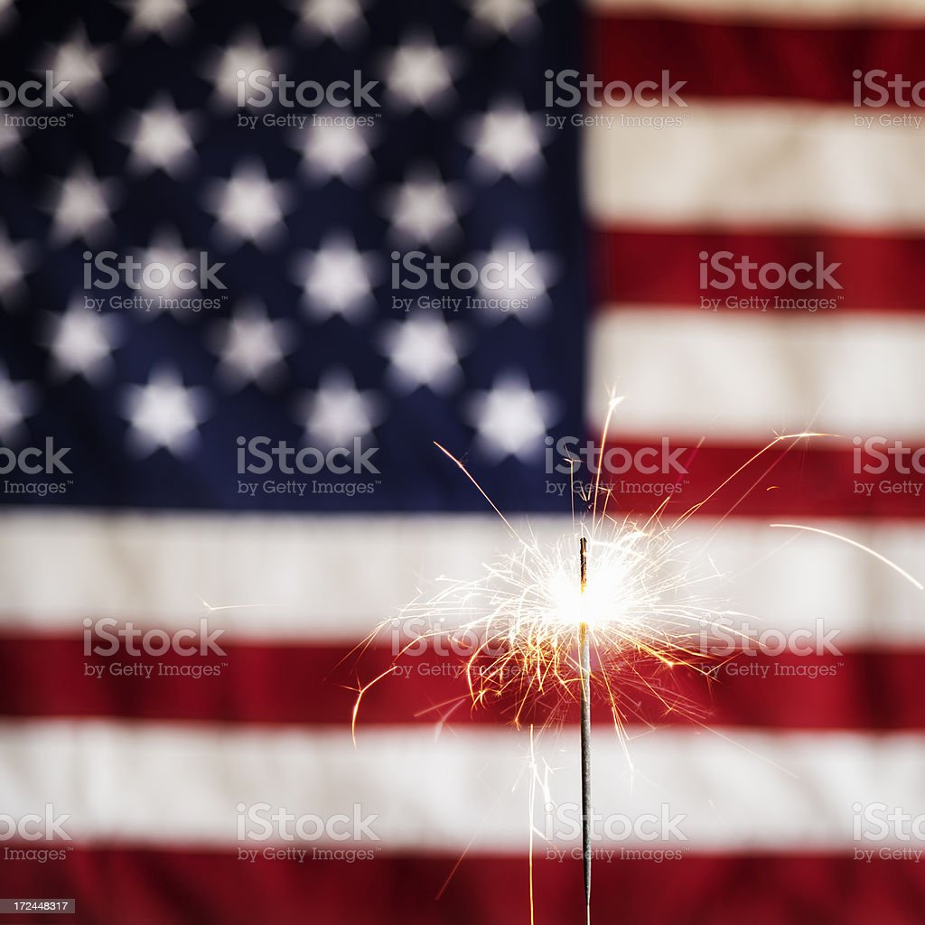 Lit Sparkler and America Flag Square royalty-free stock photo