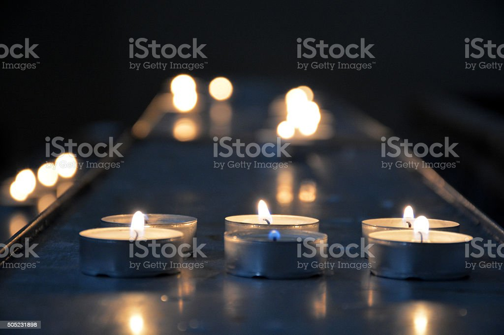 lit tealight with bokeh stock photo
