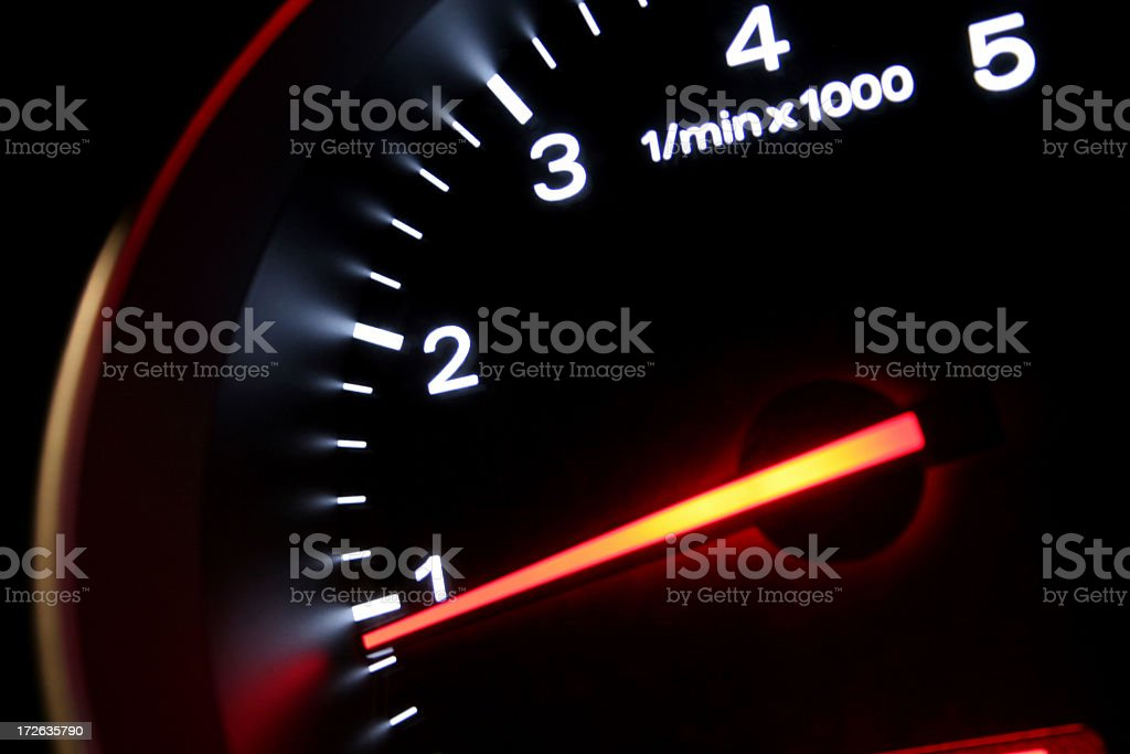 A lit up black dashboard with an orange arrow stock photo