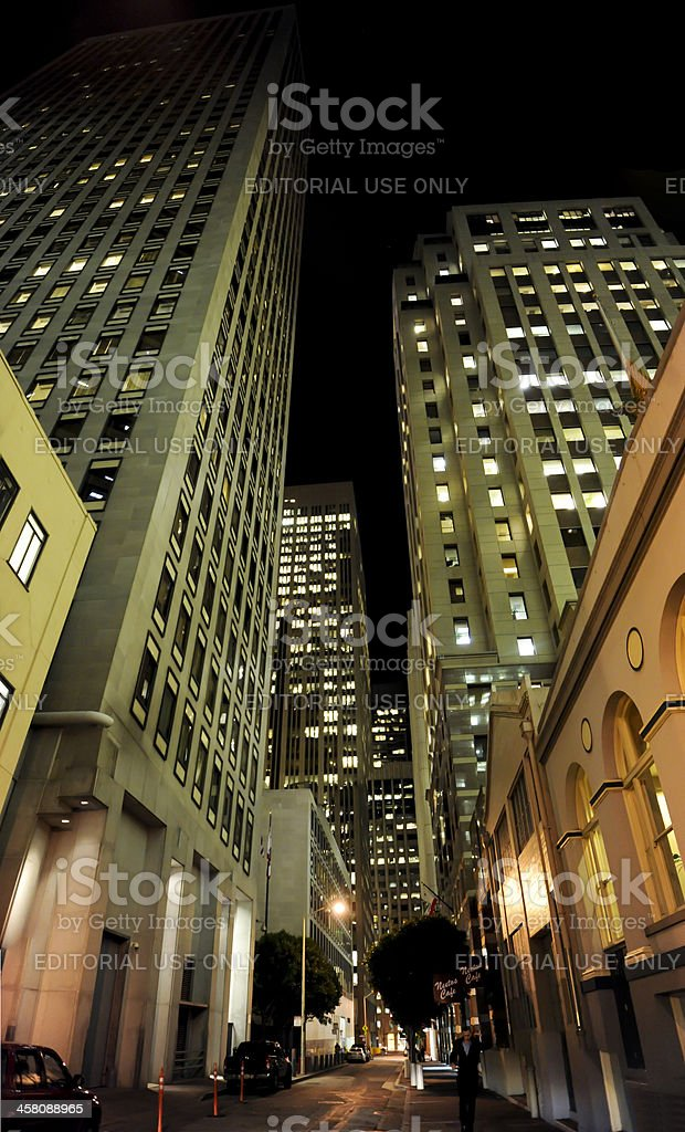 lit up skyscrapers reaching into the dark night stock photo
