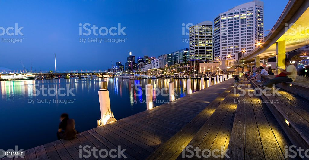 Lit up Sydney Darling Harbor at night royalty-free stock photo