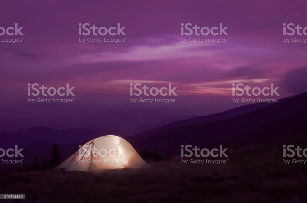 Lit up tent at Sunset stock photo