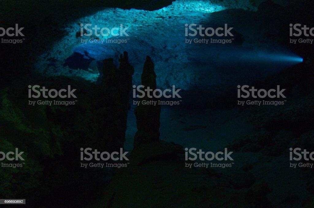 lit up view of cavern inside calavera stalactites and stalagmites stock photo