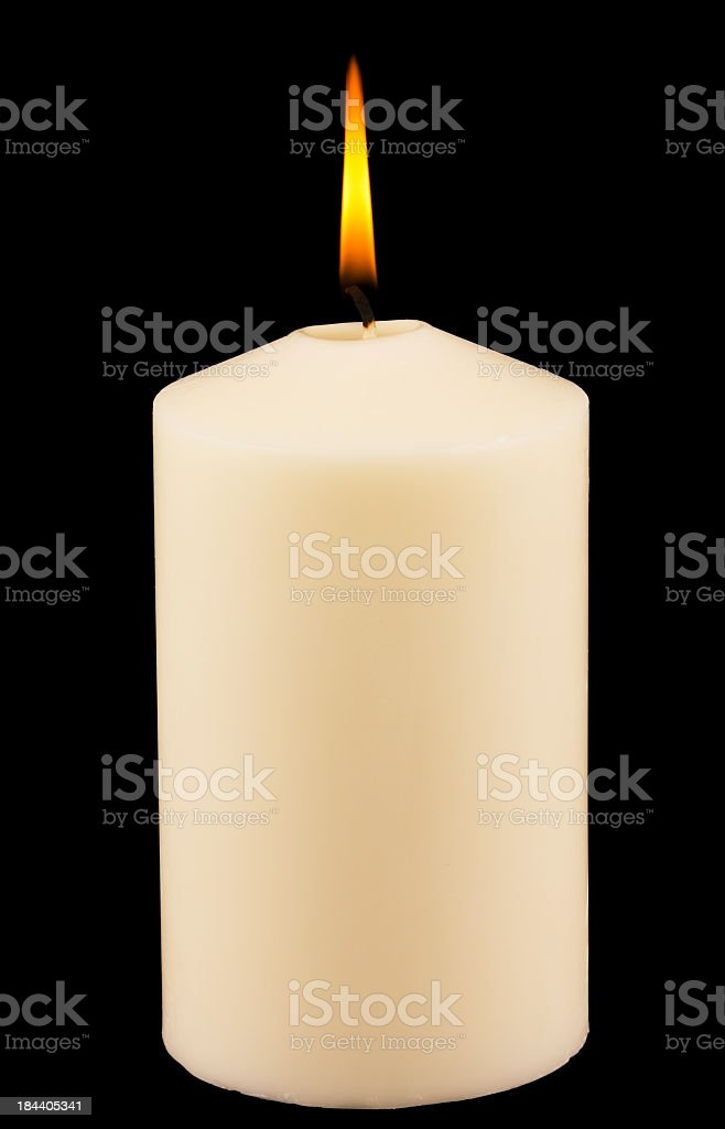 Lit white candle against black background royalty-free stock photo