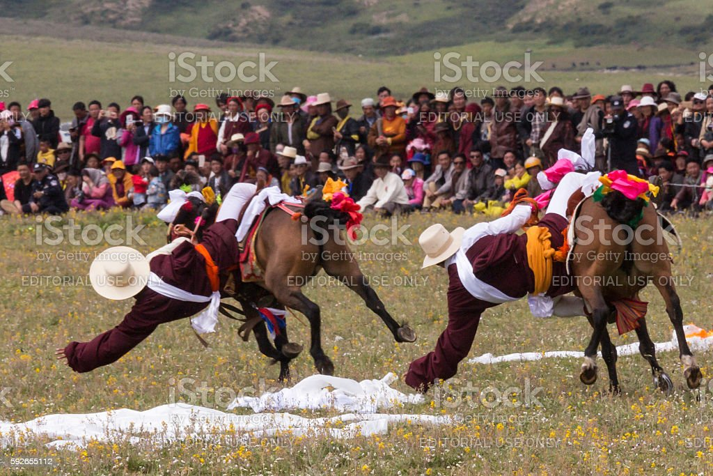 Litang Horse Festival in China: Riders Vie for Scarves stock photo