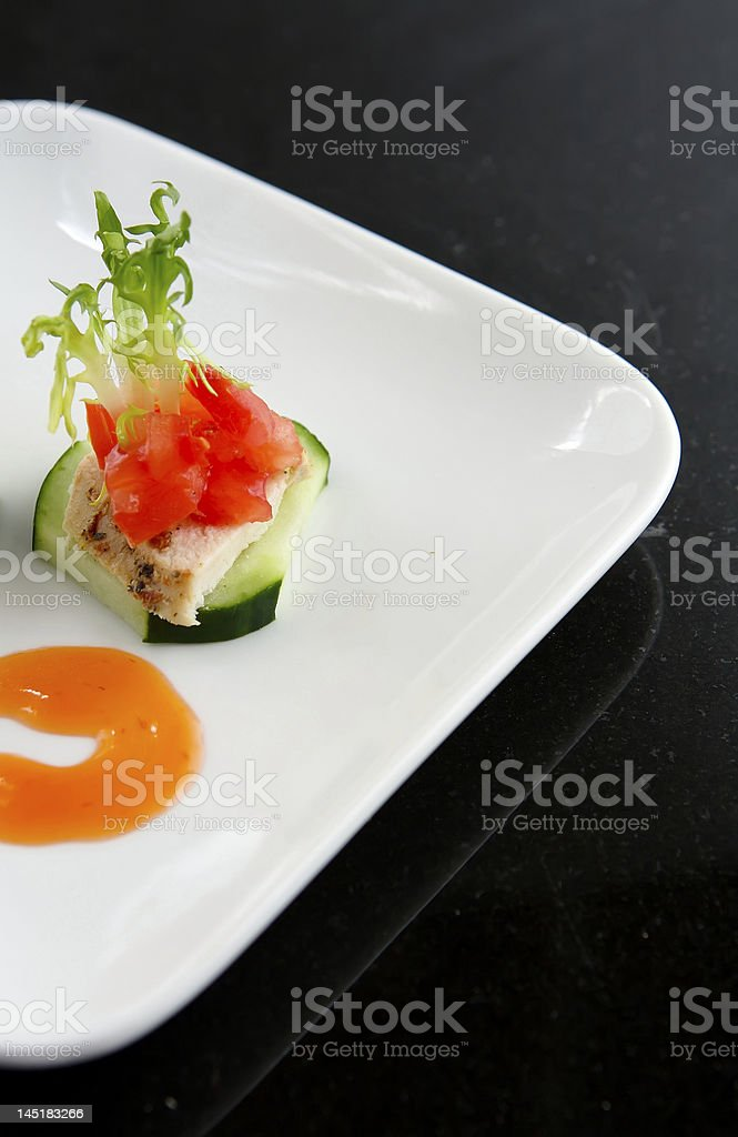 Lite Hors d'oeuvre of Chicken and cucumber stock photo