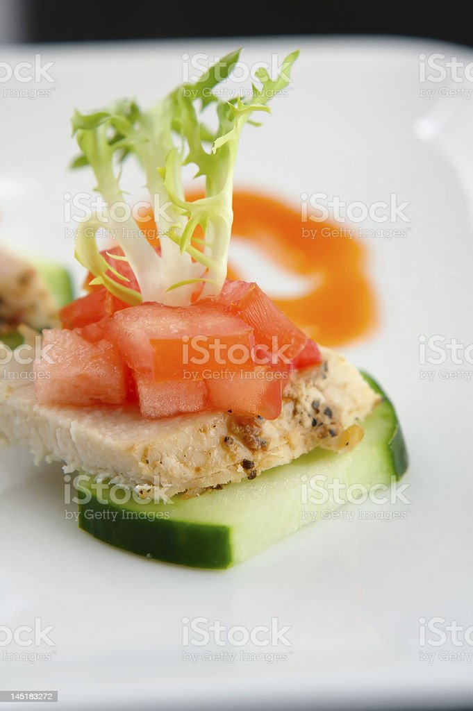 Lite Hors d'oeuvre of Chicken and cucumber royalty-free stock photo