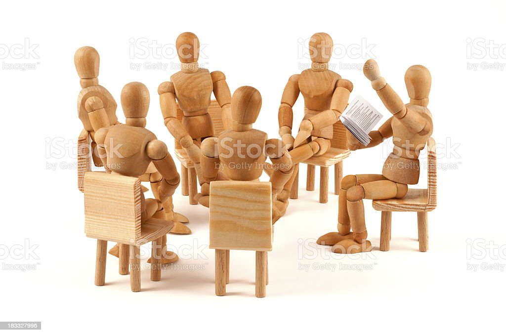 Literarily reading - circle of wooden mannequins listen stock photo